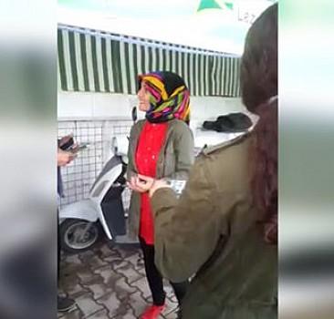 Ak Parti seçim broşürü dağıtan kıza karşıt görüşlülerin engeli